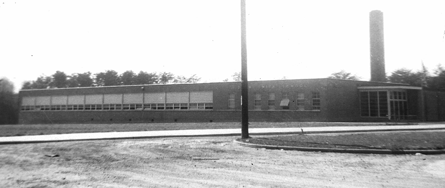 Black and white photograph of Drew-Smith Elementary School. The building is a single-story concrete structure with a brick veneer. It had fewer classrooms and amenities than the schools built for white children during this time period.